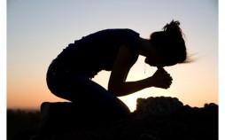 Praying young lady